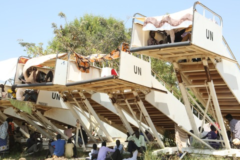Us suspends embassy activity in south sudan pbs newshour people displaced following recent fighting in juba the capital of south sudan used elevated stairways as cover from the sun inside a un compound on publicscrutiny Image collections