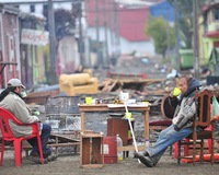 Chile Reels from Quake Aftershocks as Troops Crack Down on Looting