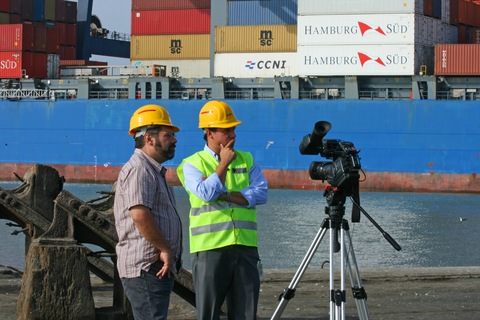 Ray Suarez preparing for interview at Lima port