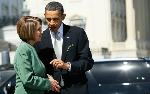 President Barack Obama talks to House Speaker Nancy Pelosi