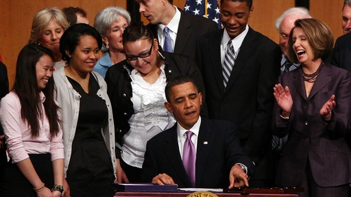 President Obama signs the health reform measure into law in March 2010. File photo by AFP/Getty.