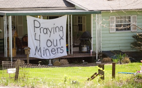 A sign near the site of a mine disaster in W.Va.; Saul Loeb/AFP/Getty Images