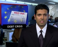 News Wrap: European Markets Reel as Spain's Debt Rating Slides