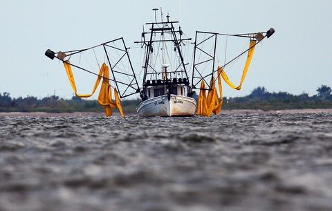 shrimp boat outfitted with booms