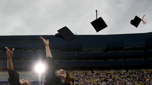 Graduates celebrate at the University of Michigan in Ann Arbor, Mich. (Jim Watson/AFP/Getty Images)