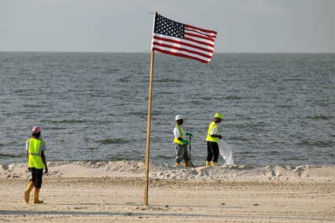 Oil spill cleanup crew on July 4 in Pass Christian, Mississippi