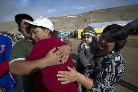 Relatives of the trapped miners; AFP/Getty