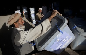 Workers unload ballot boxes at the Independent Election Commission warehouse September 20, 2010 in Kabul, Afghanistan (Paula Bronstein /Getty Images)
