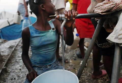 Collecting water in Haiti