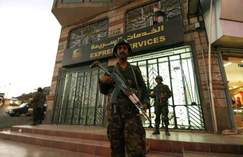 Yemeni security outside UPS branch