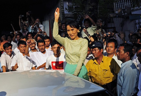 Myanmar's newly-released opposition leader Aung San Suu Kyi waves to supporters as she arrives at the National League for Democracy (NLD) headquarters in Yangon on Nov. 15, 2010.