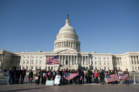 Supporters of the DREAM Act recite the Pledge of Allegiance at the Capitol on Wednesday.