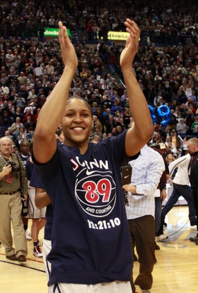 Wearing a T-shirt commemorating 89 straight wins, UConn's Maya Moore celebrates the new record; Jim Rogash/Getty Images