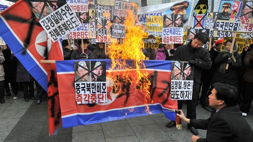 South Korean protesters burn a North Korean flag. (Jung Yeon-Je/AFP/Getty Images)
