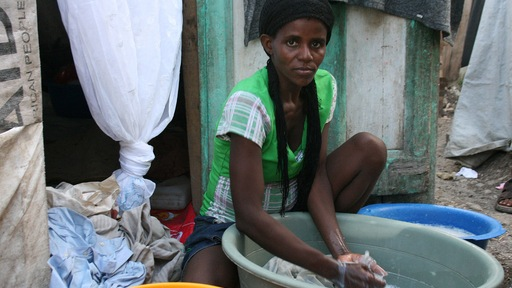 Woman in Port-au-Prince tent camp. NewsHour photo.