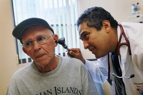 Dr. Olveen Carrasquillo checks up on Juan Gonzalez in Miami; Joe Raedle/Getty Images