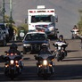 Crowds Gather as Motorcade Transfers Giffords From Hospital to Airport