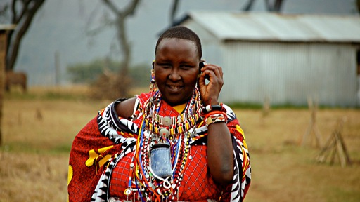 Cell phone user in Kenya. Photo by Flickr user Konrad Glogowski.