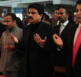 The late Pakistani Minister for Minorities Shahbaz Bhatti prays for slain Punjab Governor Salman Taseer at the Fatima Church in Islamabad on Jan. 9, 2011. Photo by Farooq Naeem/AFP/Getty Images.