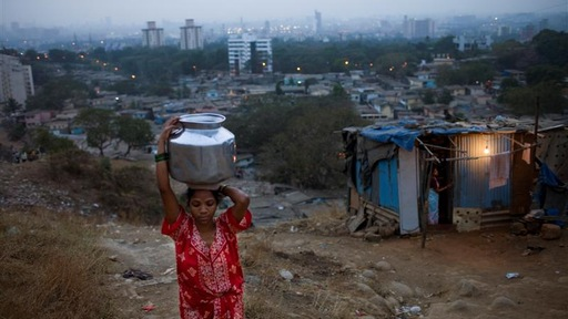 A girl carries water in India. Photo by David Rochkind/World Health Organization.