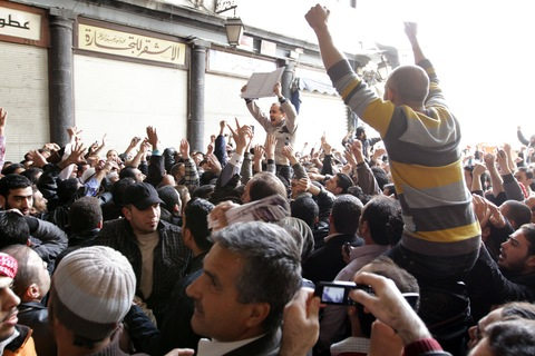 Hundreds of Syrians march from the Omayyed mosque in the centre of Damascus' Old City towards Souk Al-Hamadiyeh street on March 25, 2011 chanting: 'Daraa is Syria' and 'We will sacrifice ourselves for Syria.