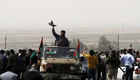 Libyan rebels flee from Ras Laniuf to Uqayla 12 miles east of Ras Lanouf, on March 30, 2011, as loyalist forces overran the Libyan key oil town. (MAHMUD HAMS/AFP/Getty Images)