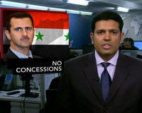 News Wrap: Syrian President Refuses to Lift Decades-Old State of Emergency