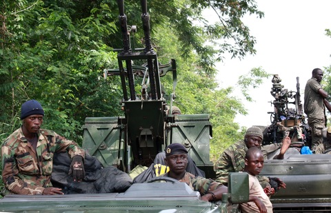 Members of Pro-Ouattara forces hold their weapons on March 29 in Duekoue in western Ivory Coast. (Zoom Dosso/AFP/Getty Images)