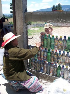 Stacking bottles for the schoolhouse wall. Photo courtesy of Hug It Forward
