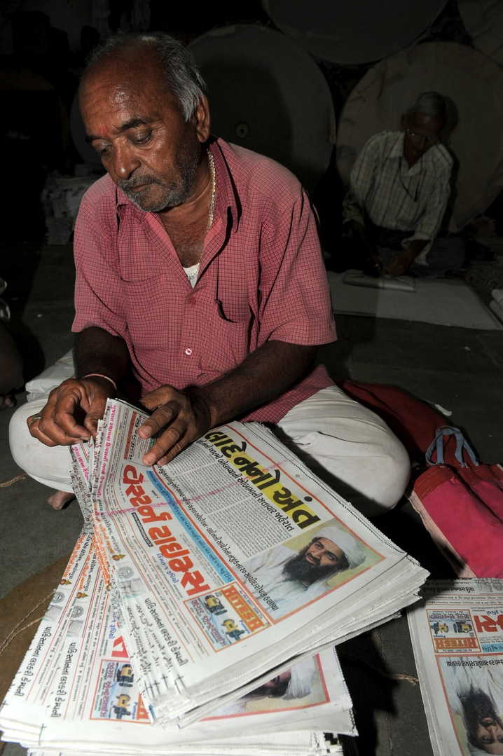 Indian Man Counts Newspapers