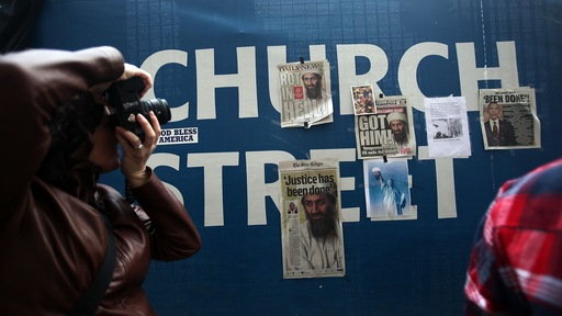 Articles about the death of Osama bin Laden are seen near the World Trade Center site. Getty
