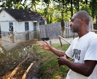 MEMPHIS, TN - Jesse Willis looks over his flooded yard and home May 9, 2011 in Memphis, Tennessee. Willis purchased the property about 4 years ago and did extensive rehab work inside the home. (Photo by Scott Olson/Getty Images)