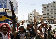 Tribesmen loyal to Yemeni opposition tribal chief Sheikh Sadiq al-Ahmar show the V-sign for victory as they stand guard near his home in the capital Sanaa on June 6, 2011. (Ahmad Gharabli/AFP/Getty Images)