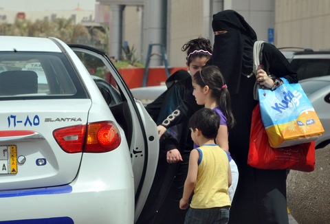 Saudi woman and children enter a taxi in Riyadh. Photo by Fayez Nureldine/AFP/Getty Images