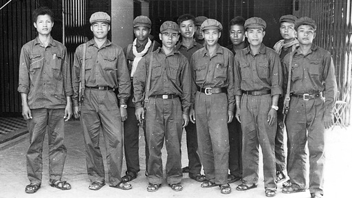 Him Huy, fourth from left, leading group of Khmer Rouge guards at Tuol Sleng