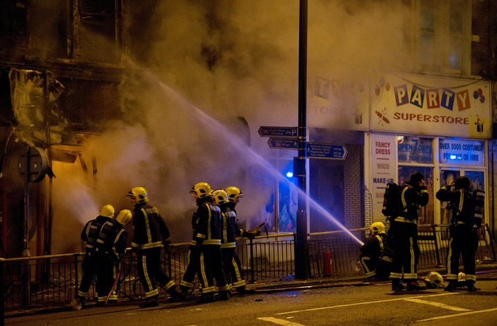 Firefighters Battle Riot Blaze