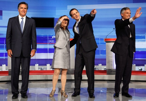 Republican presidential candidates Mitt Romney, Michele Bachmann, Tim Pawlenty and Jon Huntsman take the stage for a debate Thursday in Ames, Iowa. Photo by Chip Somodevilla/Getty Images