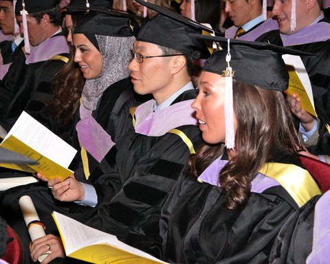 University of Michigan School of Dentistry graduates take an oath to uphold high professional standards at this year's graduation ceremony in Ann Arbor -- a Campus and Careers county type.; Creative Commons photo courtesy flickr.com/umdent