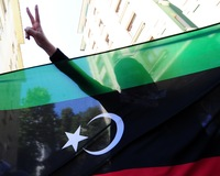 Libyan Rebels Claim Control of Most of Tripoli as Gadhafi Eludes Capture