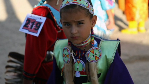 A young Lakota Sioux girl at the annual Pine Ridge powwow. Photo by Mike Fritz.
