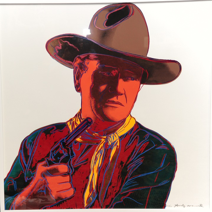 An Andy Warhol limited edition signed print from the Cowboys and Indians series is on display at an auction preview of items owned by film star John Wayne; Photo by ROBYN BECK/AFP/Getty Images