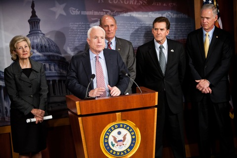 Sen. John McCain speaks as Sens. Kay Bailey Hutchison, Dan Coats, Jim DeMint and Ron Johnson (look on during a news conference to introduce a Republican jobs proposal; Photo by Brendan Hoffman/Getty Images