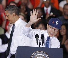 South Korean President Lee Myung-bak waves as President Barack Obama looks on at General Motors' Orion Assembly Plant in Lake Orion, Michigan, to promote a free trade agreement; Photo by Bill Pugliano/Getty Images