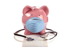 Piggy bank with mask and stethoscope for healthcare cost concept