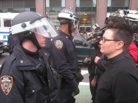 Arun Venugopal/WNYC Rev. Ann Kantsfield faces off with NYPD at the Canal Street site.