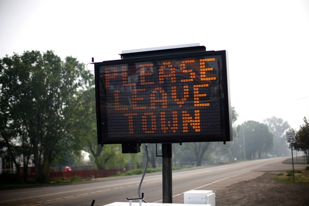 An evacuation sign asks residents to leave June 9, 2011 in Eagar, Arizona.