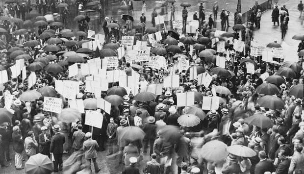 A crowd of depositors gather in the rain outside Bank of United States after its failure in 1931 during the Great Depression.