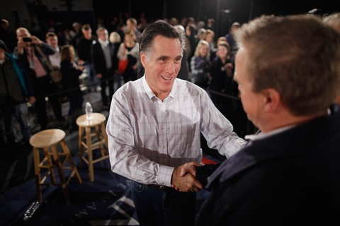 Mitt Romney greets supporters during a Thursday town hall meeting in Salem, N.H.; photo by Chip Somodevilla/Getty Images