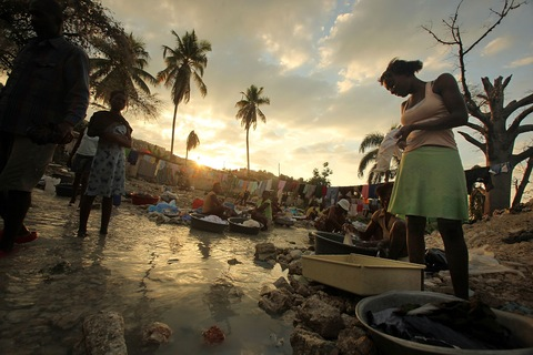 Haitians wash clothes in a stream on Jan. 8, 2011; Photo by Mario Tama/Getty Images