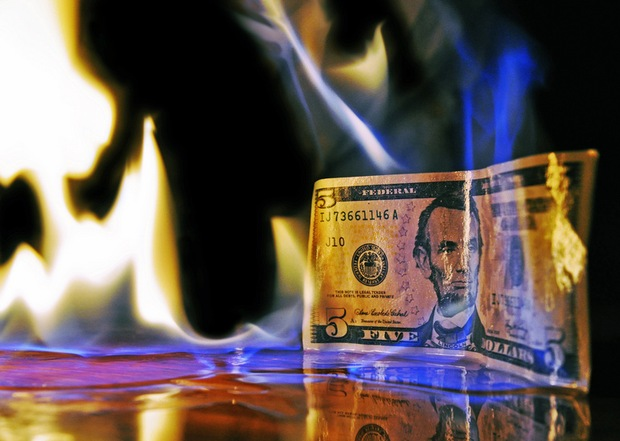 Image of $5 bill on fire by flickr user Mike Poresky.